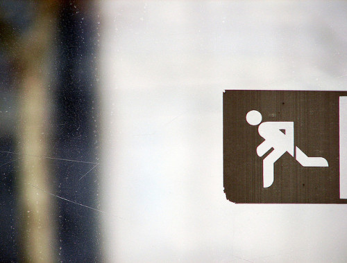 Image of sign of person running