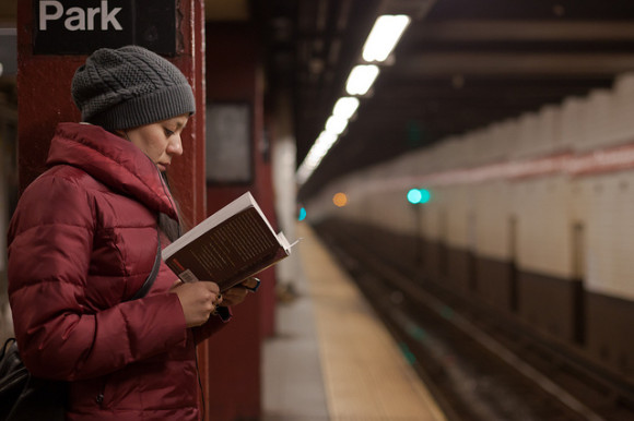 Person Reading on their Commute