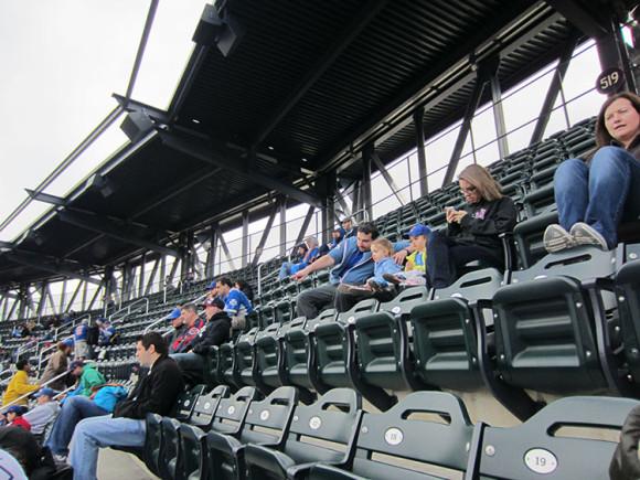 Dad teaching child about baseball at Citi Field