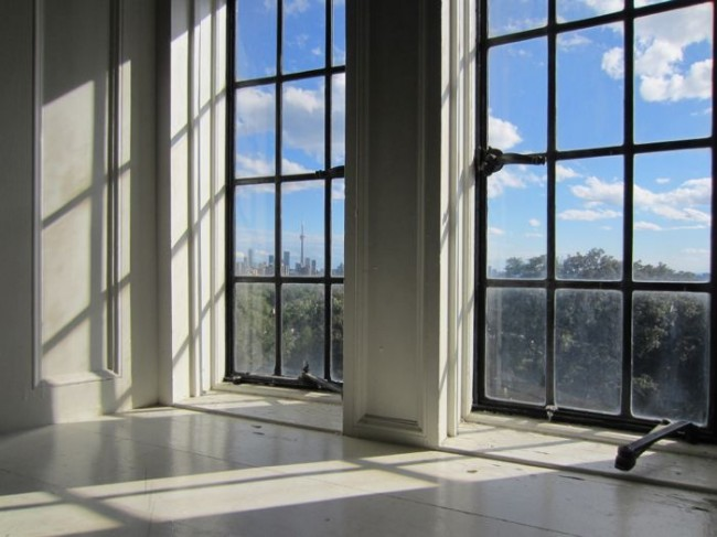 A view of Toronto cityscape from a window in Casa Loma