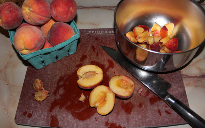 Dicing up peaches for homemade ice cream