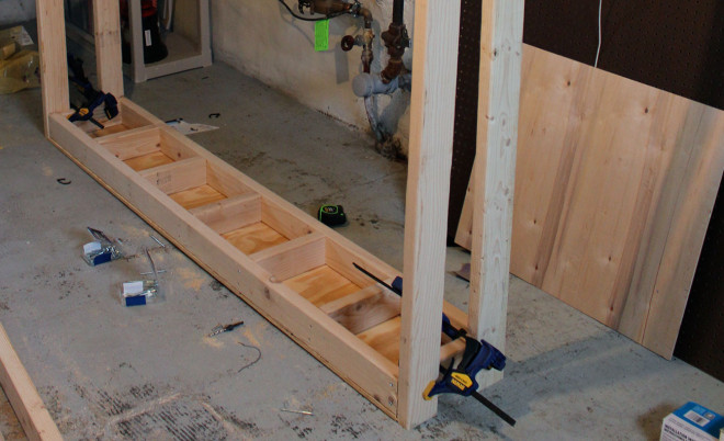 Attach beams to top shelf of workbench