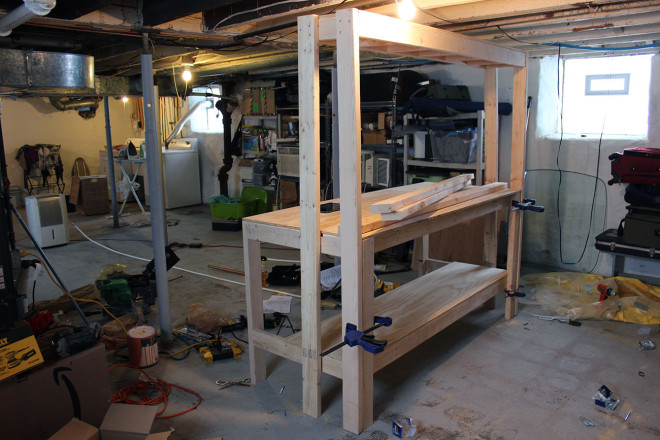 Attach top shelf to base of workbench