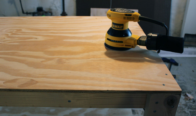 Sand plywood tops of the workbench
