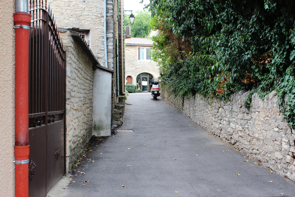 Quintessential alley with moped in Goult, France
