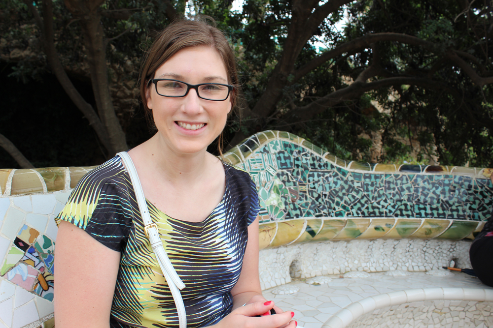 Nicole sitting on a bench in Park Güell